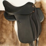 The ReactorPanel Elegance Dressage Saddle, memel Leather & Doeskin Option.