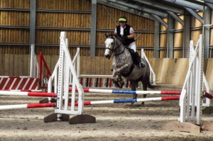Helen and Lily jumping in their Elevation Mono Flap, Native Pony Fit, custom seat, doeskin seat and Knee Rolls.