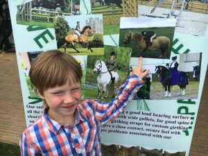 Fergus Spots Himself on the Native Pony Saddle Company Banner at The Royal Highland Show in June.