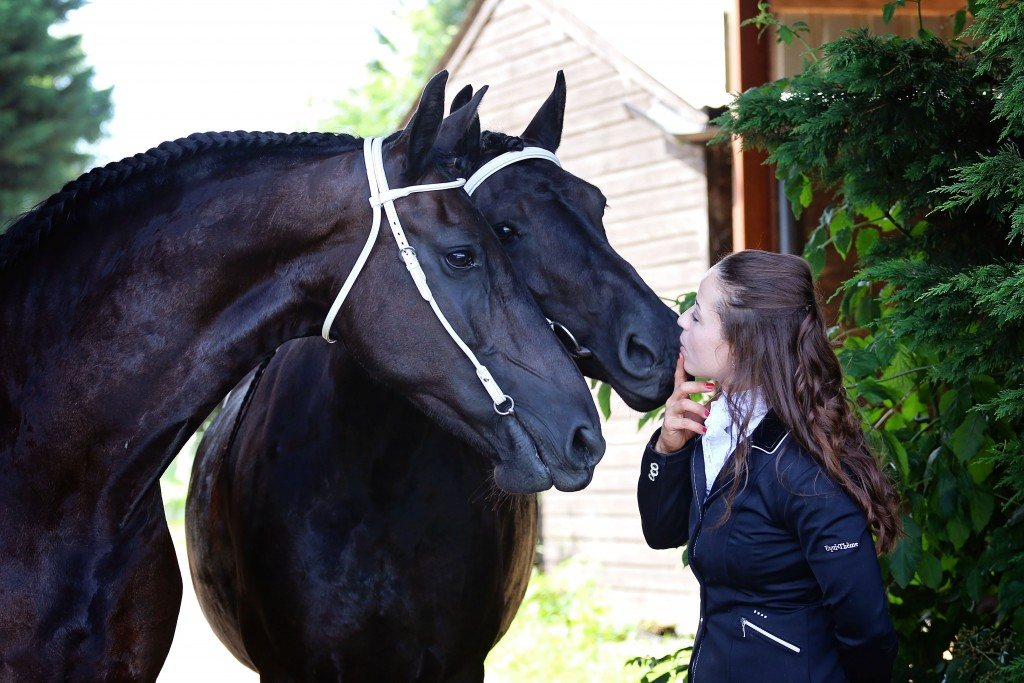 Clare Gangadeen and saddles for two Friesian Horses